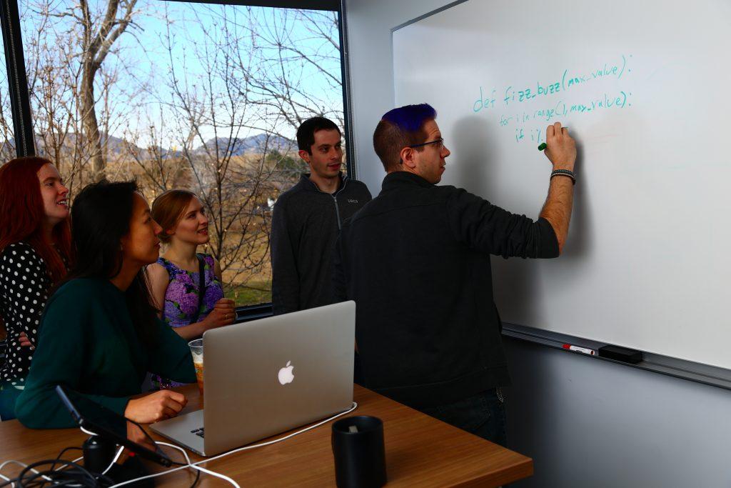 Uber Team Writing on Whiteboard Photo