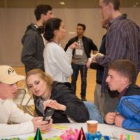 CU students discuss an app as part of the CU Boulder Innovation & Entrepreneurship Cross-Campus Team.